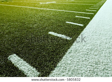 Sideline of football field with yardage marks