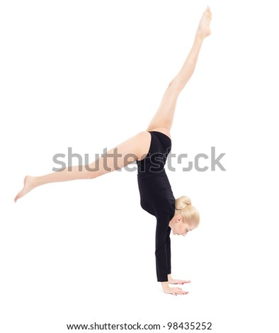 sideview isolated portrait of beautiful young blonde woman gymnast training hand stand