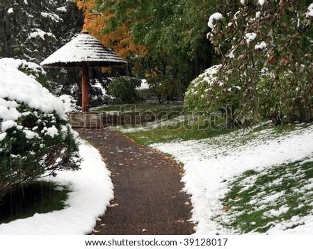 Sidewalk in Japanese garden near Normandale college in Minnesota during snowfall - stock photo