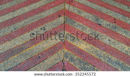 sidewalk, red and yellow color walkway. arrow background - stock photo