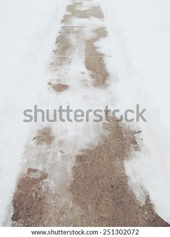 Sidewalk with snow - stock photo