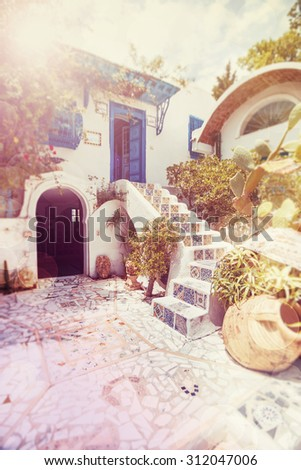 Sidi Bou Said - traditional courtyard of a typical house, Tunisia. Blur Shot with a selective focus. Instagram toning effect. - stock photo
