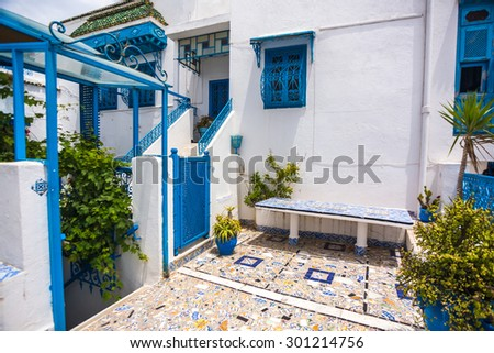 Sidi Bou Said - typical building with white walls, blue doors and windows, Tunisia - stock photo