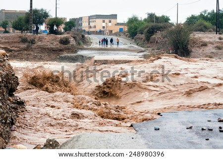 Sidi Ouaaziz, Morocco - November 28: Flooding in region Souss Massa Draa, Morocco, 2014. A powerful stream of water destroyed bridge in place Sidi Ouaaziz - stock photo