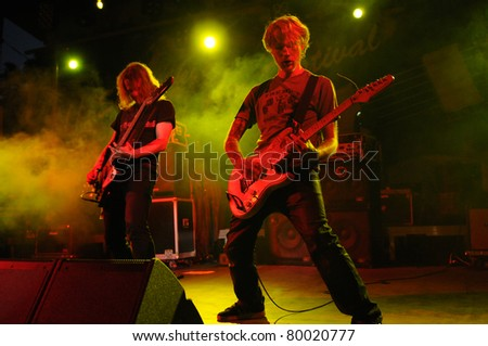 SIEDLCE, POLAND - JUNE 26: Plum performs on stage at Siedlecki Rock Open Air Festival on June 26, 2011 in Siedlce, Poland - stock photo