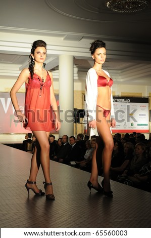 SIEDLCE, POLAND - NOVEMBER 19: Models showcasing designs from Triumph collection walk the catwalk at the Siedlce Fashion Evening on November 19, 2010 in Siedlce, Poland