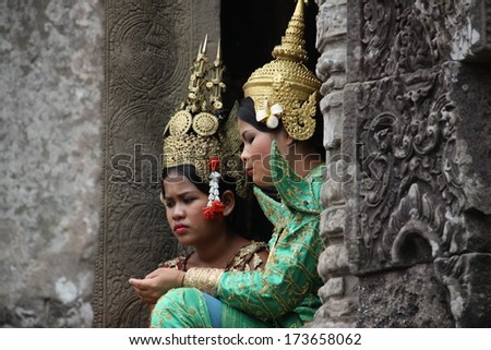 SIEM REAP, CAMBODIA - APRIL 6: An unidentified cambodians in national dress poses for tourists in Angkor Wat, April 6, 2012 on Siem Reap, Cambodia.  - stock photo