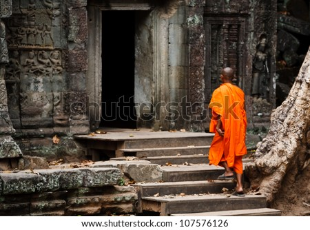 SIEM REAP, CAMBODIA - DECEMBER 26: Unidentified monk enters an ancient temple at the most visited  historic UNESCO World Heritage site Angkor Wat, Siem Reap on December 26, 2008 in Cambodia.