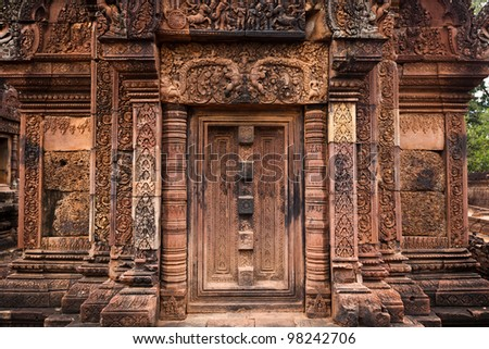 SIEM REAP, CAMBODIA: Detail of intricate carvings on a door at Banteay Srei temple, Angkor Wat.