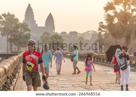 SIEM REAP, CAMBODIA - FEBRUARY 27, 2015 : Unidentified people visit the famous Angkor Wat Temple on February 27, 2015 - stock photo