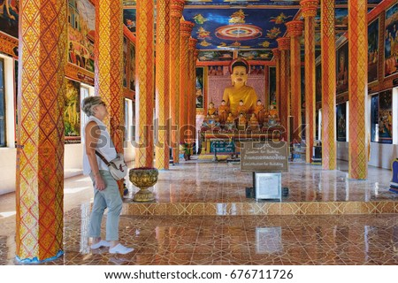 Siem Reap, Cambodia - February 4, 2016: Unidentified tourists visit to modern Theravada Buddhist monastery built near the historical Lolei temple