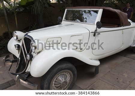 Siem Reap, Cambodia - January 29 2016:  Classic vintage Citroen Traction Cabriolet 11B,  circa 1939, cream colour with a brown leather top