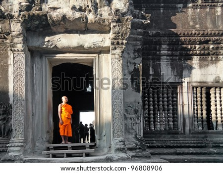 SIEM REAP, CAMBODIA - JANUARY 07: Monk posing in Angkor Wat temple, January 07, 2012, Siem Reap, Cambodia. Buddhism is currently estimated to be the faith of 96% of the Cambodian population.