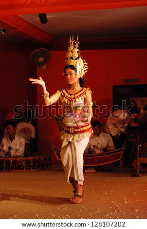 SIEM REAP, CAMBODIA - MAY 3 : Khmer classical dancer performing in full traditional costume May 3, 2009 in Siem Reap, Cambodia.Angkor Wat is the most visited place in Cambodia. - stock photo