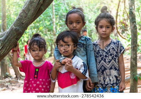 SIEM REAP, CAMBODIA - MAY 2 : Unidentified childrens of Cambodian in the forest at kabal spean on May 2, 2015 in Siem Reap, Cambodia