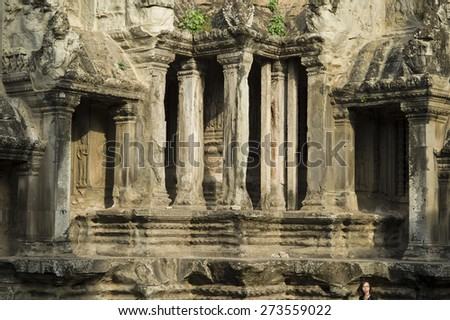 SIEM REAP, CAMBODIA - NOV 17: The famous Angkor Wat on November 17, 2014 near Siem Reap, Cambodia. The temple was hidden for many years and covered by the rain forest.  - stock photo