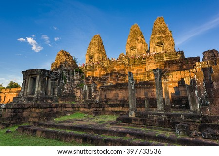 Siem Reap, Cambodia, 14 Nov 2015: Tourists gahtering at peak of Pre Rup Temple for sunset viewing. - stock photo