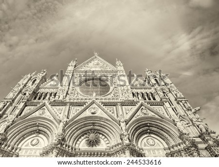 Siena Cathedral against sunset sky, Italy. - stock photo