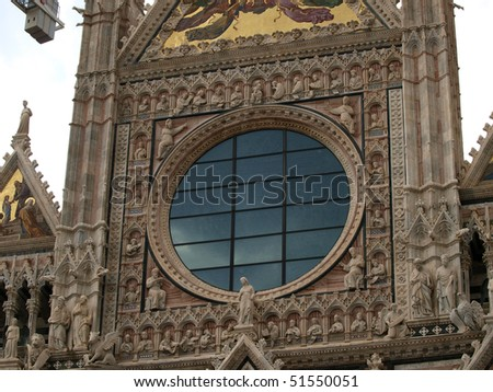 Siena - Duomo facade. The Duomo of Siena, which was built in the 12th and 13th centuries, is one of the prettiest churches in Gothic style in Italy - stock photo