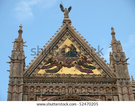 Siena - Duomo facade.The large central mosaic, the Coronation of the Virgin, is the work of Luigi Mussini - stock photo