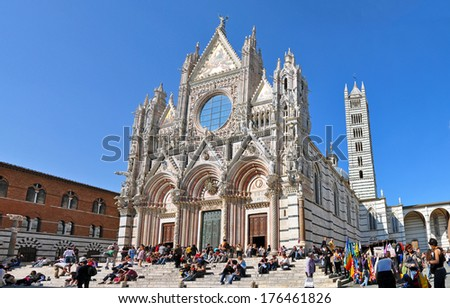 SIENA, ITALY - APRIL 17: Tourists in front of cathedral on April 17, 2011 in Siena, Italy. Duomo is a major tourism attraction in Siena.