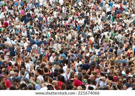 "SIENA, ITALY - AUGUST 16: Spectators in anticipation of start of annual traditional Palio di Siena horse race in medieval square ""Piazza del Campo"" August 16, 2014 in Siena, Italy - stock photo"