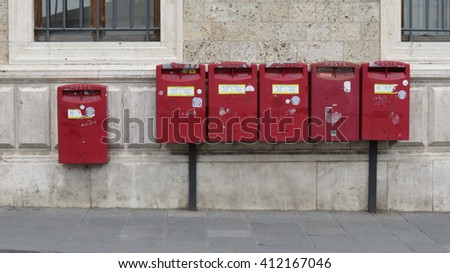 SIENA, ITALY - CIRCA APRIL 2016: row of letter box mailboxes for sending mail - stock photo