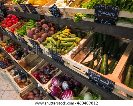 SIENA, ITALY - CIRCA JULY 2016: Fruits and vegetables on display at small grocery store produce market greengrocer