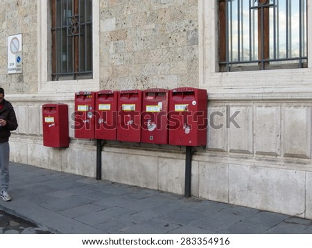 SIENA, ITALY - DECEMBER 19, 2014: row of letter box mailboxes for sending mail - stock photo