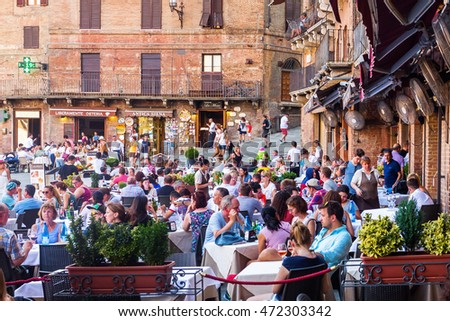 Siena, Italy - July 07, 2016: unidentified people on the Piazza del Campo. It is the main square of the historic center of Siena and is regarded as one of Europes greatest medieval squares