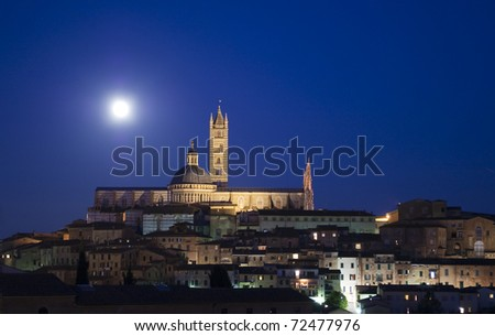 Siena old town cityscape by night and full moon in Tuscany Italy - stock photo