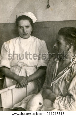 SIERADZ, POLAND - CIRCA FIFTIES: vintage photo of nurse and patient in hospital