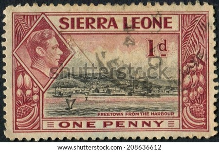 Sierra Leone-Circa 1938: a stamp showing Freetown Sierra Leone from the Harbour.