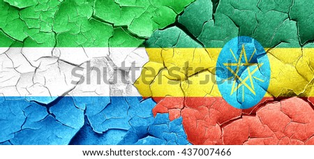 Sierra Leone flag with Ethiopia flag on a grunge cracked wall - stock photo