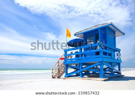 Siesta Key Beach, Florida USA, colorful lifeguard house on a beautiful summer day with ocean and blue cloudy sky - stock photo