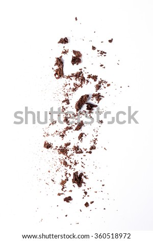 Sifting dark chocolate chips over white background.