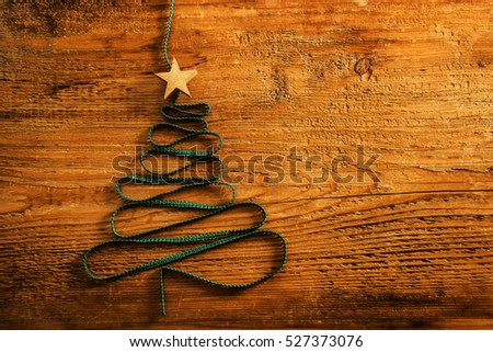 Sigh symbol Christmas Tree from a lot colorful confetti, lace and wood star toy on retro vintage style wooden texture background. Empty copy space for inscription. Idea of merry new year 2017 holiday