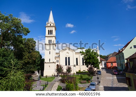 SIGHISOARA, ROMANIA - JULY 20, 2016: St. Joseph's Roman Catholic Cathedral in Sighisoara, Romania; Sighisoara is considered the most beautiful and well preserved inhabited citadel in Europe.