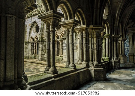 sight of the columns of the gallery of the cloister of the Romanesque cathedral of Oporto, Portugal