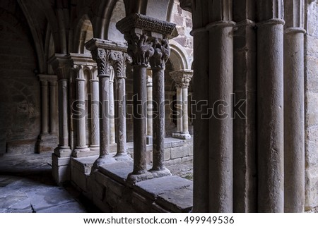 sight of the galleries of the cloister with arches, props and columns of the Romanesque abbey of Santa Maria the Real one in aguilar of Campoo, Palencia, Spain