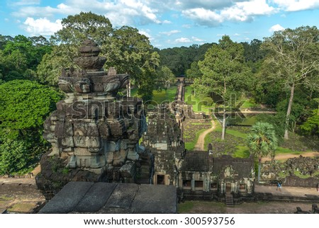 sight of the gopura of the exterior enclosure, of the roadway and the ponds of the baphuon in the archaeological angkor thom place in siam reap, cambodia
