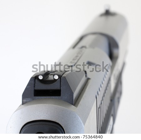 Sights aligning on a semi-auto handgun that is isolated on white - stock photo