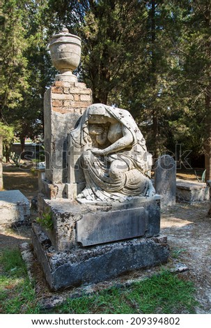 Sightseeing in Corfu City: interesting place - ancient and old british cemetery. Here sculpture of Maria - stock photo