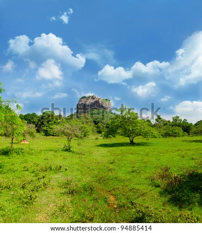 Sigiriya ( Lion's rock ) is a large stone and ancient palace ruin in the central  Sri Lanka. Panorama of the three vertical frames and horizontal one. - stock photo