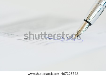 Sign a contract or agreement with an ink pen