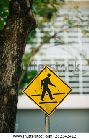 Sign across the road in portrait. - stock photo