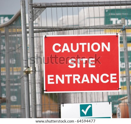Sign at Building Site Entrance displayed on wire fence - stock photo