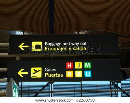sign at the madrid airport to show the way to the terminals etc - stock photo
