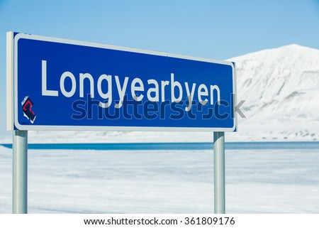Sign Beautiful white snowy landscape. Mountains and blue sky on the background. Sunny weather. Longyearbyen, Svalbard. - stock photo