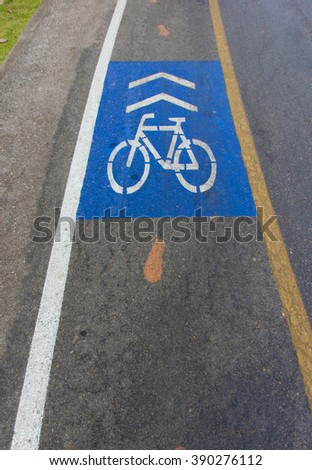 Sign  bicycle on floor , message for way of bicycle